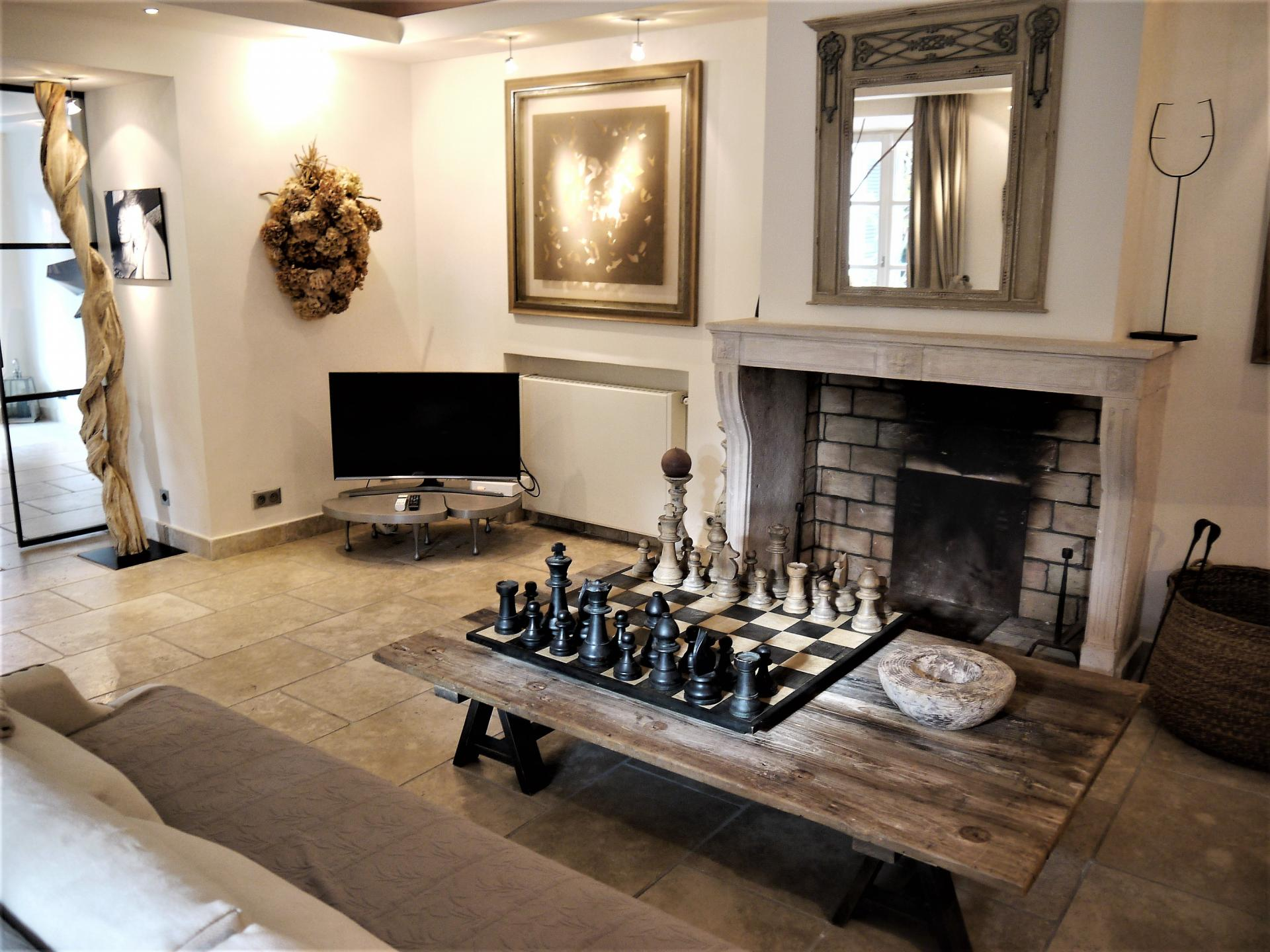 THE FIREPLACE AND A BIG CHEST SET FOR LOVELY EVENINGS IN A VILLA RENTAL IN SAINT TROPEZ